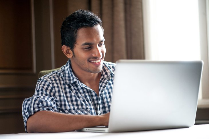 Young man working remotely on a laptop