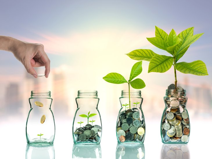 Jars of change with plants sprouting.