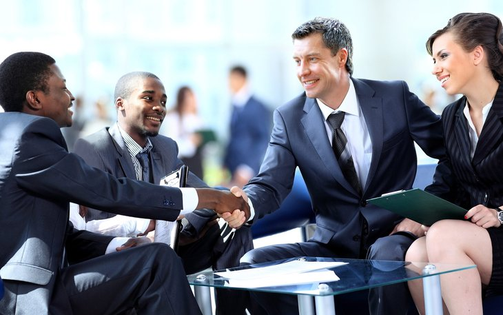 business people men woman diverse shaking hands deal agreement meeting