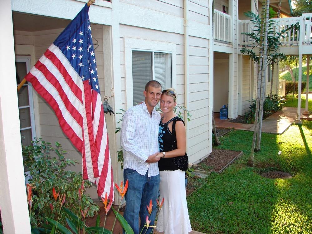 A couple stand outside of a condo near Honolulu