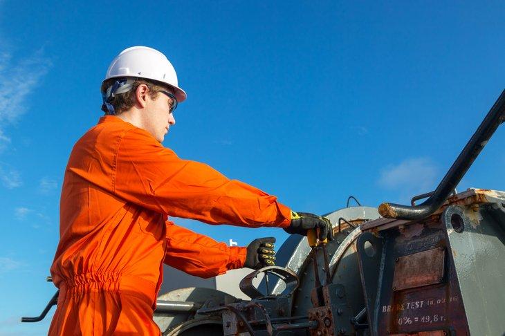 An engineer operates a hoist on a work site